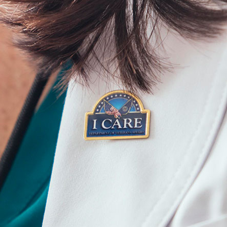 Doctor wearing 'ICARE' button